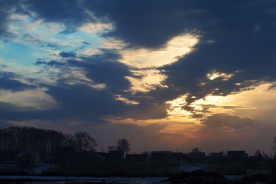Sunrise and clouds over the village
