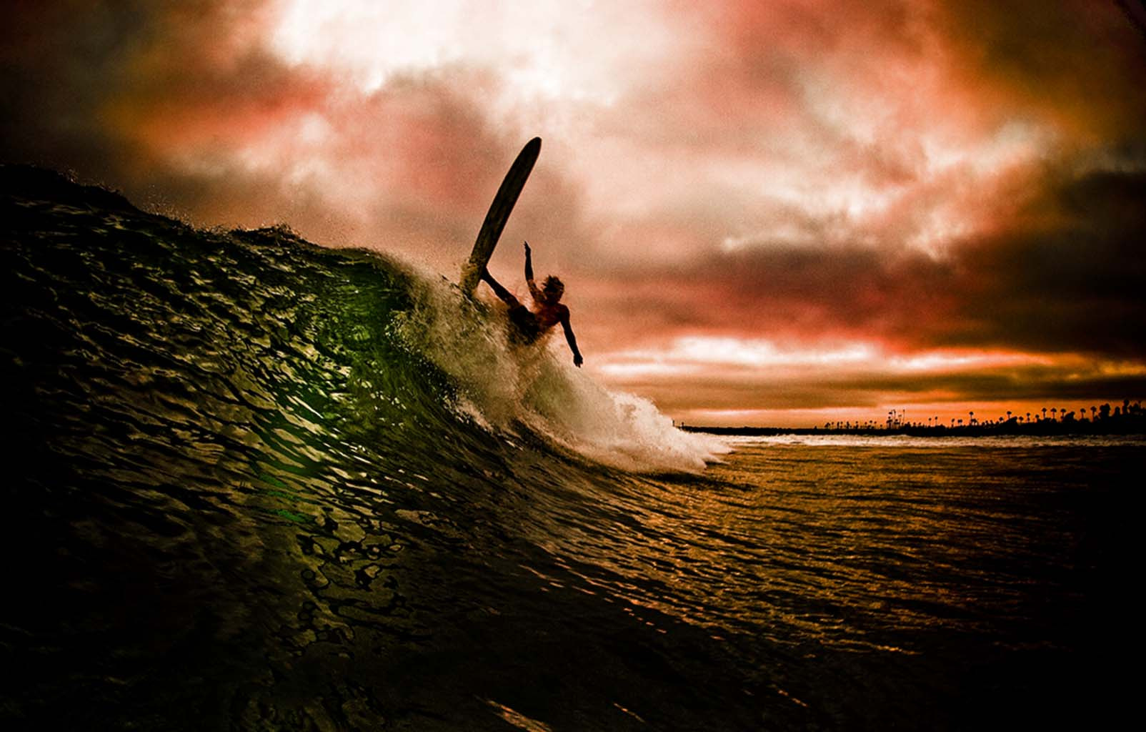 Photograph Aggressive longboarding during a storm. by Jeff Farsai on 500px