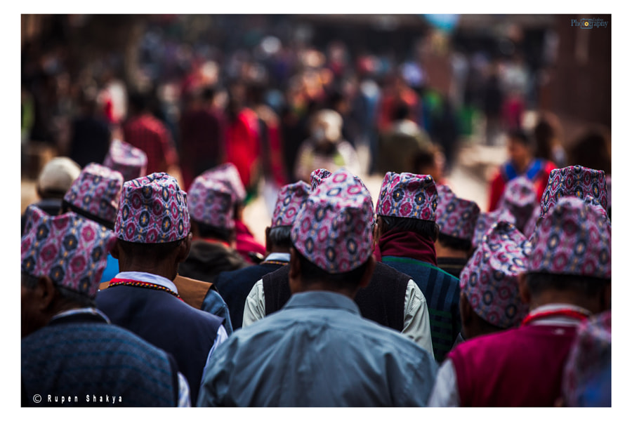 A group of nepali men in Dhaka Topi around Patan Durbar Square by Rupen Shakya on 500px.com