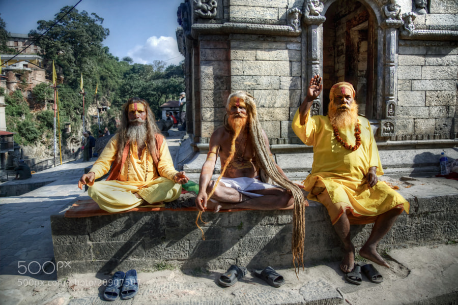 """The three holy man, Sadhu (""""Holy Man"""") at Pashupatinath Temple, Kathmandu, Nepal  Pashupatinath Temple (Nepali: पशुपतिनाथको मन्दिर) is one of the most significant Hindu temples of Lord Shiva in the world, located on the banks of the Bagmati River in the eastern part of Kathmandu."""