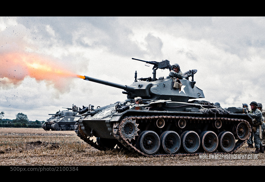 Restored M24 Chaffee fires blank shells during a WW2 re-enactment battle at the Victory Show 2011