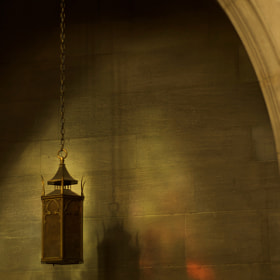 Lighting fixture in the Centennial Chapel at Christ Church Cathedral, Cincinnati, Ohio.  Light on the wall is from stained glass windows above and opposite.