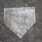 Home plate on an empty baseball field.