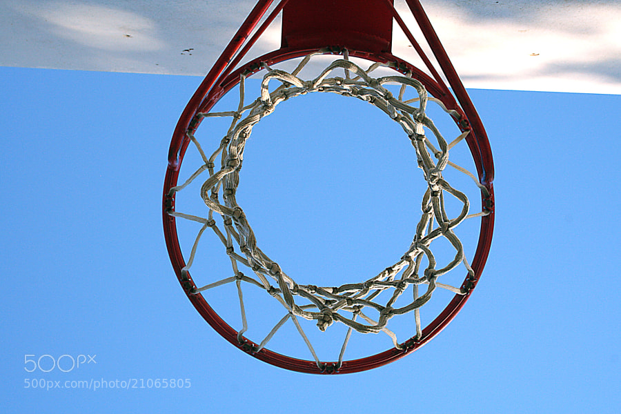 Basketball hoop at empty park.