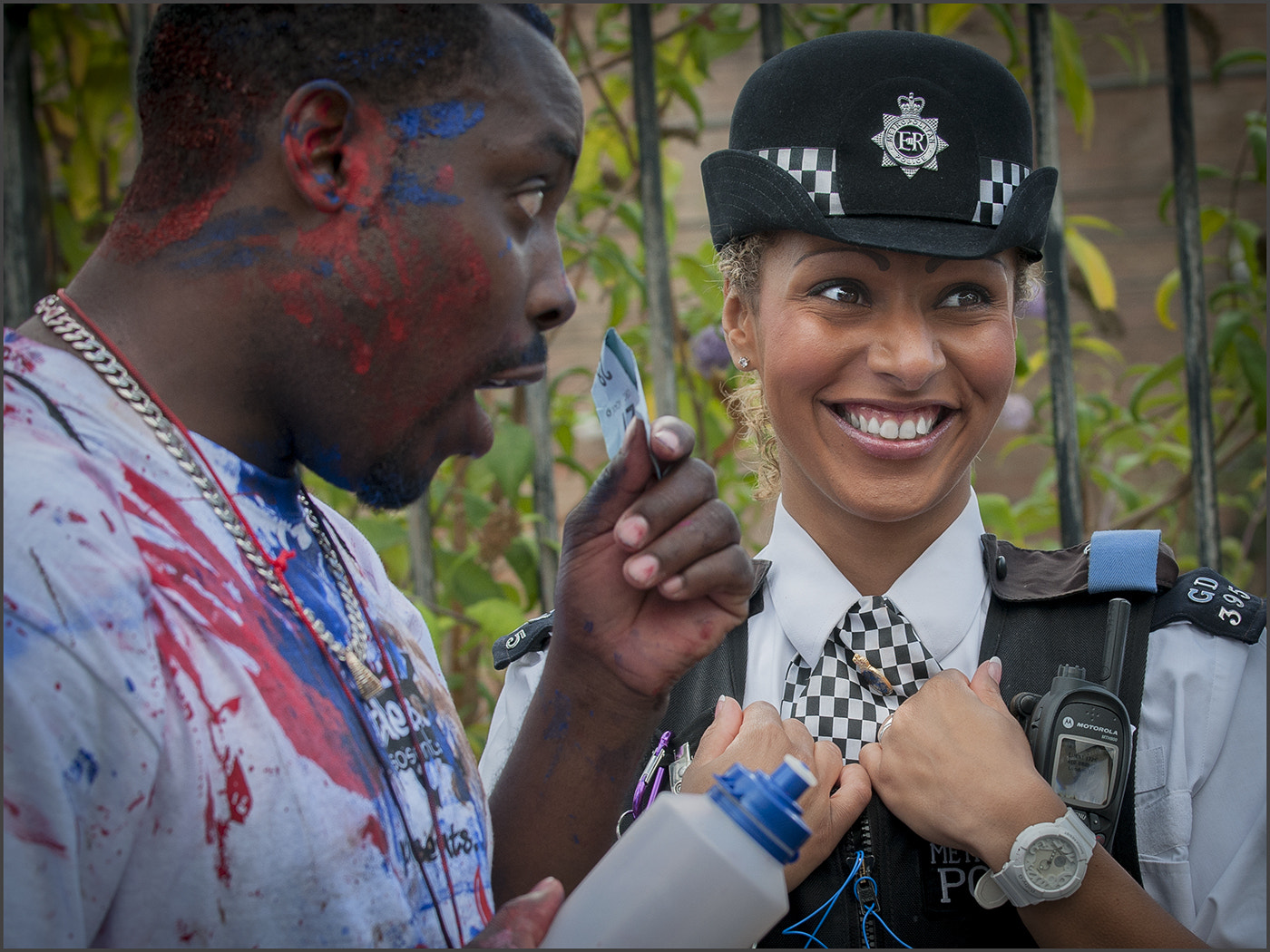 Photograph Police Woman being Teased by Tony Smith on 500px