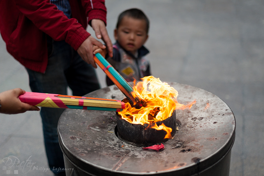 Photograph father helping his son burning incense in Shanghai city god temple by Philippe Lejeanvre on 500px