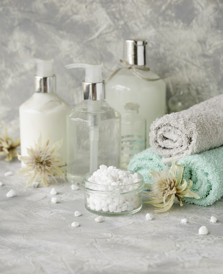 Spa set on a white marble table with a stack of towels, selective focus by Viktoria Agureeva on 500px.com