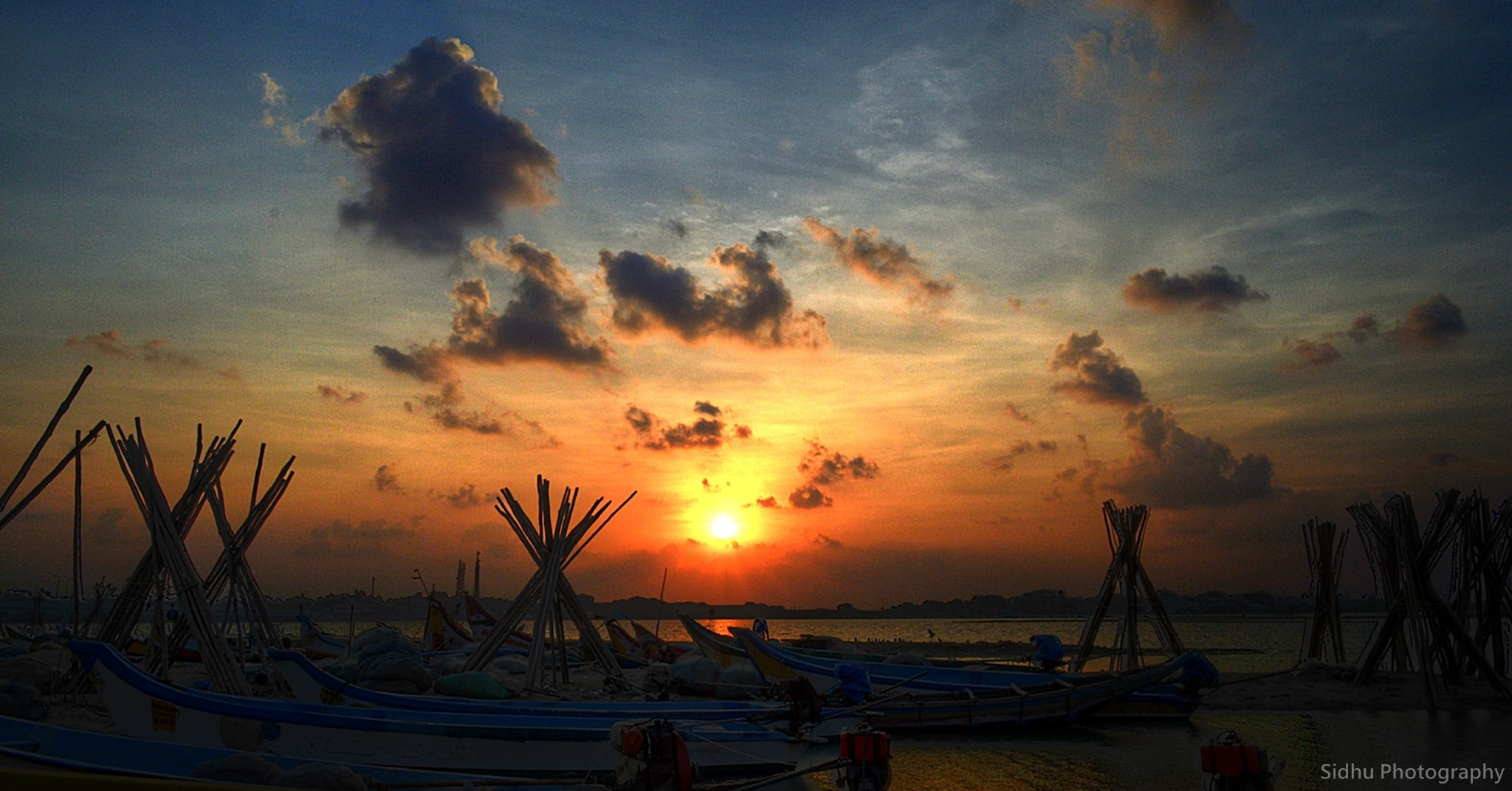 Photograph Sun is Getting Set , Light is Getting Down......... Fishing boats already headed in to Shore...... by Arun Siddharth on 500px