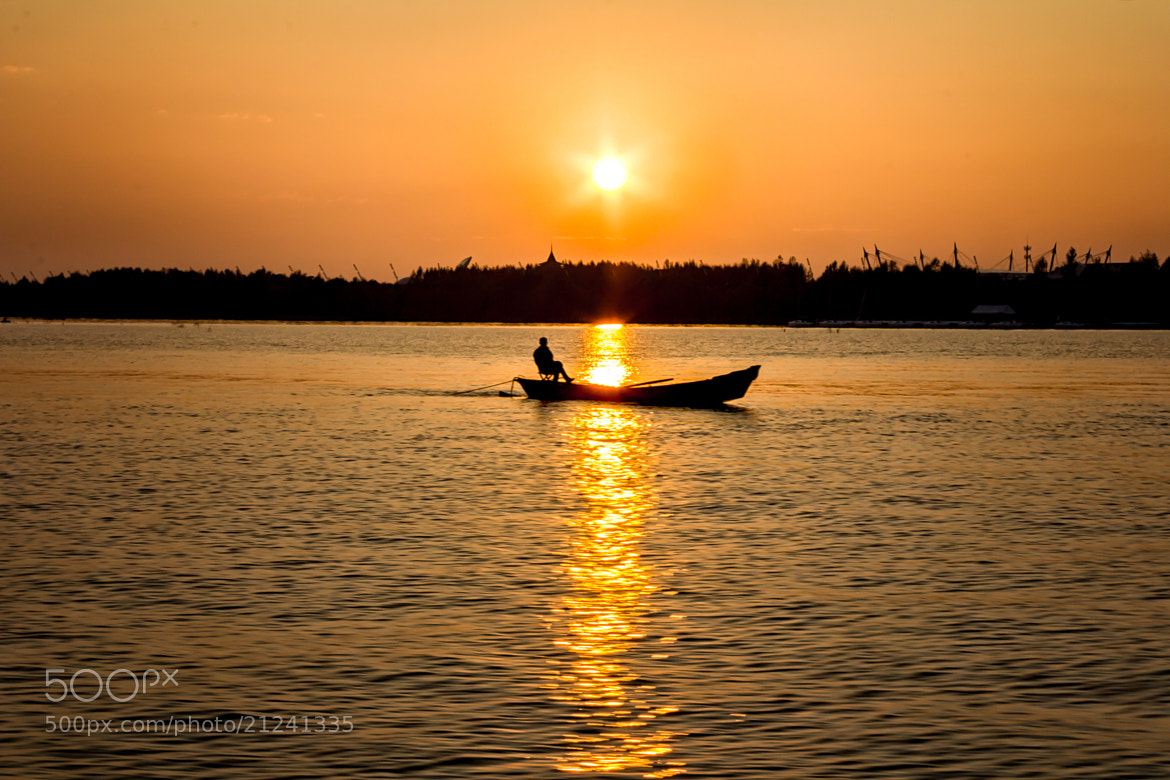 Photograph Person sitting in a boat by Liyao Xie on 500px