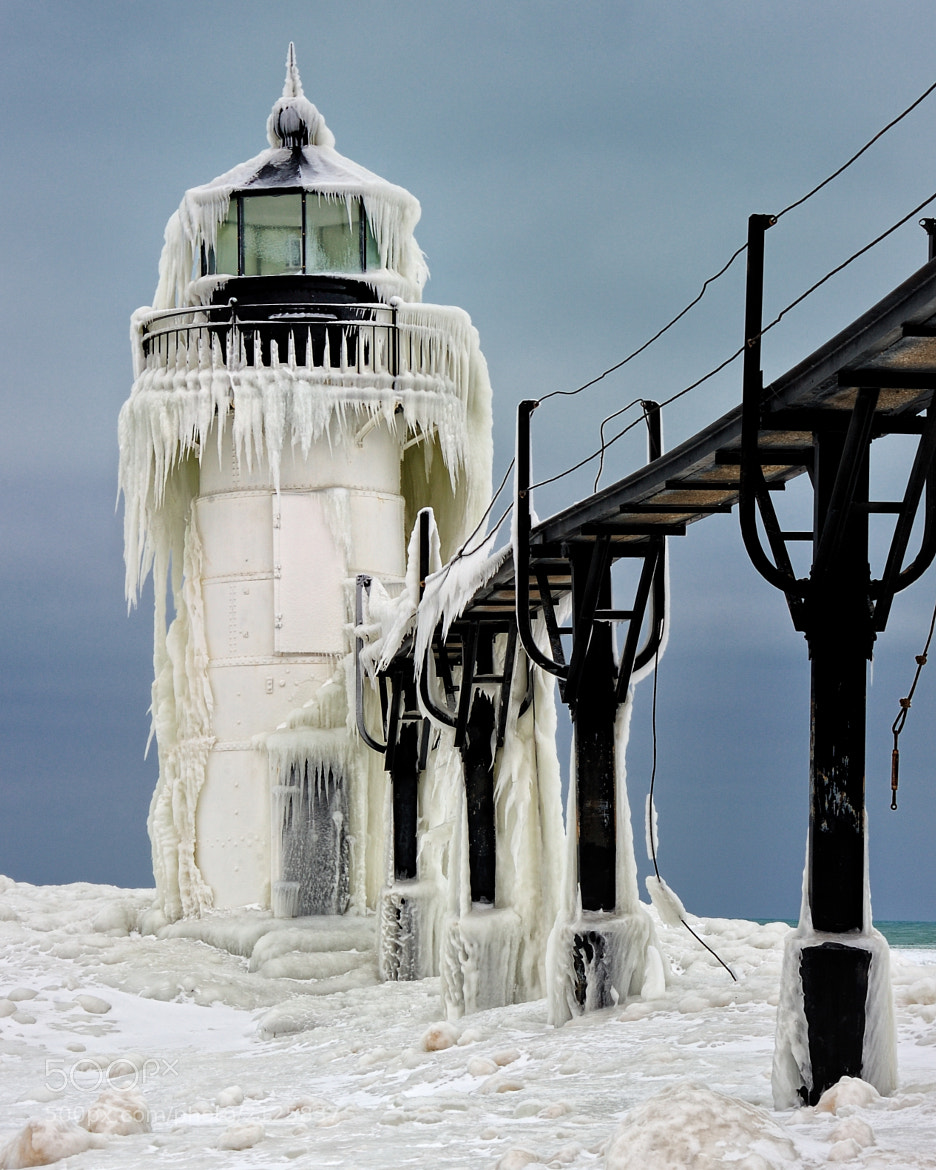 "Photograph ""Frozen Light"" St. Joseph Northpier Lighthouse, St. Joseph, Michigan by John McCormick on 500px"