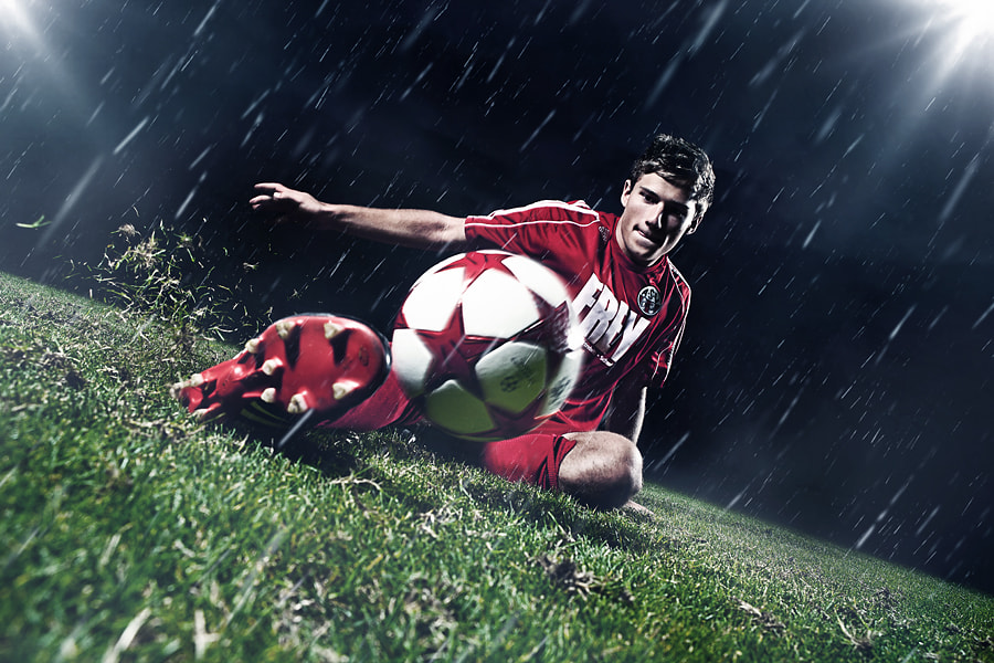 Photograph sliding tackle by Christoph Ruhland on 500px