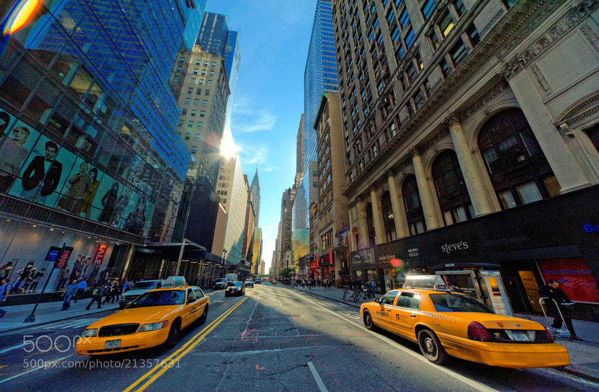 Photograph Yellow cabs in the heart of New York City - The models in ad to the left like it ;-) by Michael FRANCHITTI on 500px