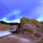 A purple sky takes ove a section of Mullholand Highway in Calabasas.