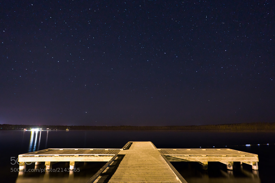 Photograph Starry Night Over Lake Wabamun by Mike Bowzeylo on 500px