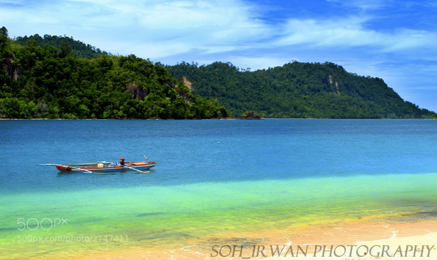 Photograph boat on crystal clear water by Irwan Suwito on 500px