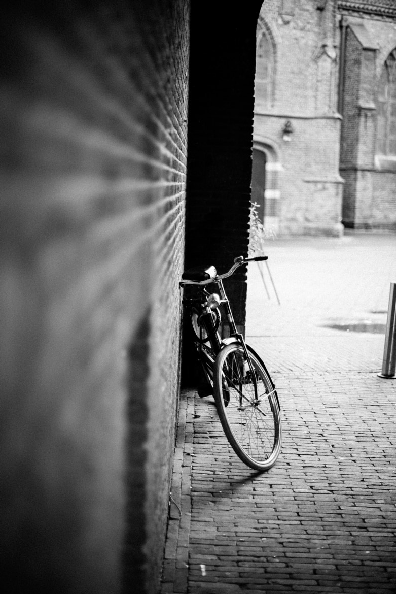 Photograph Bike in alley by Huub K on 500px