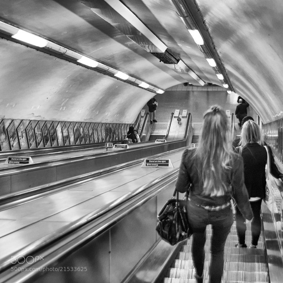 Entering a tube station in London.