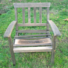 Old chair that has ben outside for many years.