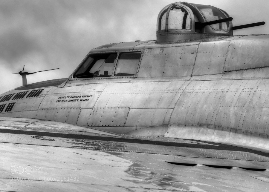 "B-17G ""Aluminum Overcast"" sits under heavy overcast and light rain at Gwinnett Briscoe Field, Lawrenceville, GA USA"
