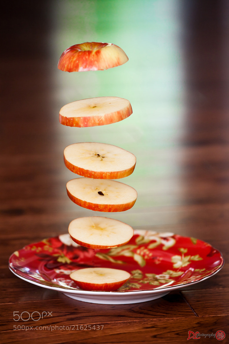 Photograph falling apple slices by Ding Luo on 500px