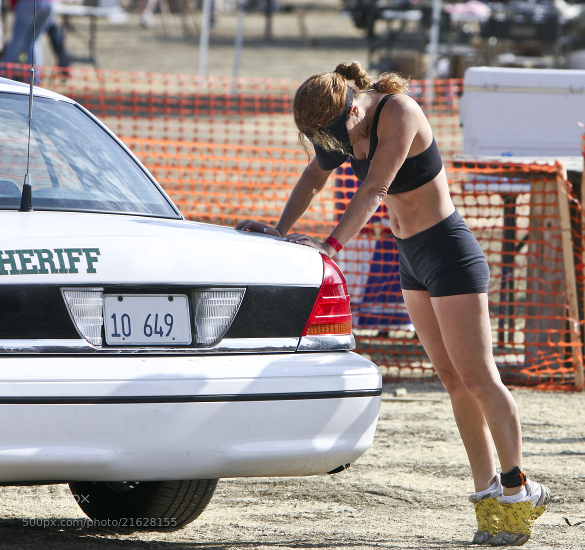 Photograph Jogging - A Woman and the Sheriffs Car by Mark Hendrickson on 500px