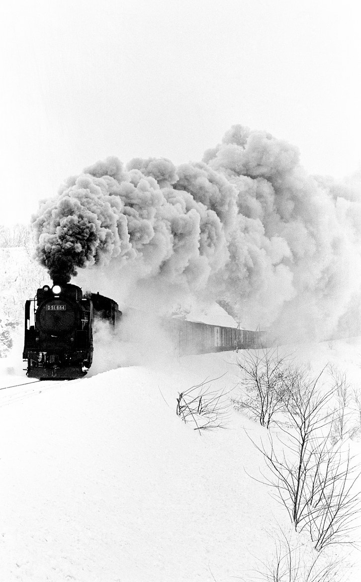 Photograph A freight train by HIRO INO on 500px