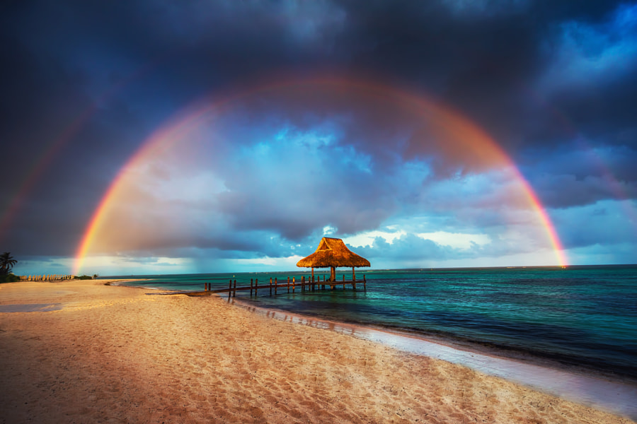 Rainbow over the Tropical beach in Punta Cana, Dominican Republi by Valentin Valkov on 500px.com