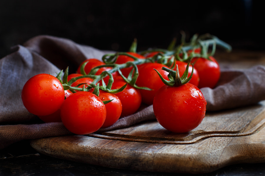 Cherry tomatoes on a dark background by Ekaterina Fedotova on 500px.com