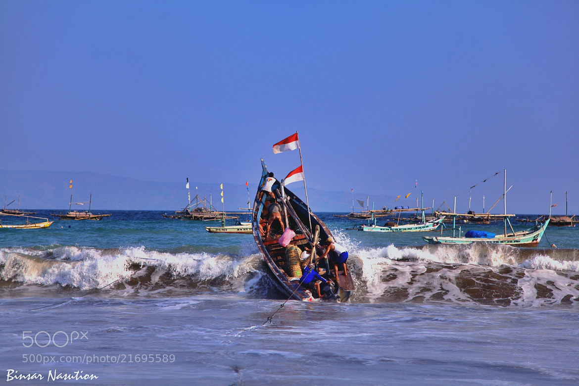 Photograph Challenging the Sea by Binsar Nasution on 500px