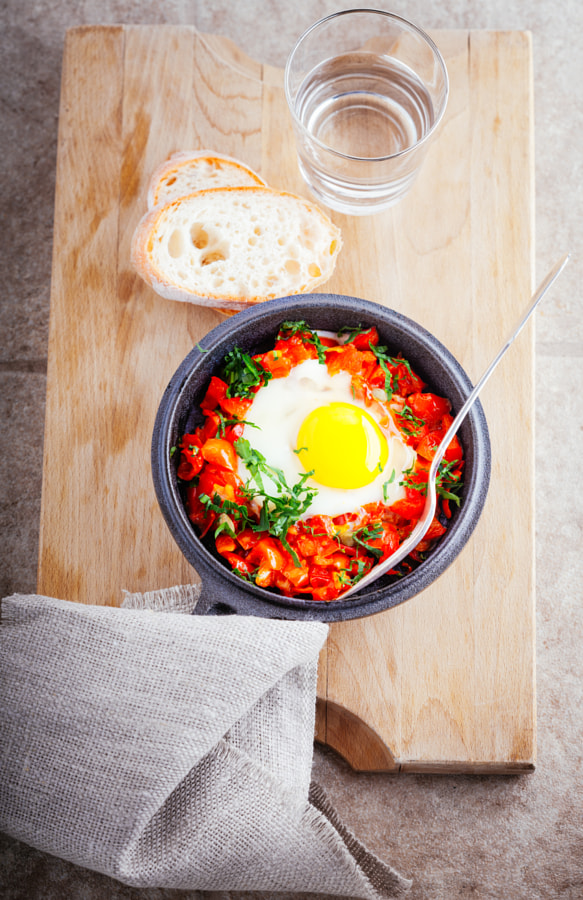 Traditional middle eastern dish of shakshuka in a pan. by Konstantin Senyavskiy on 500px.com