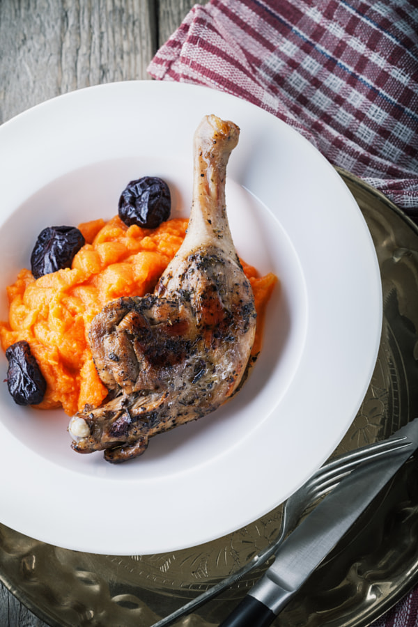 Roasted duck leg with mashed carrot and dried prunes by Konstantin Senyavskiy on 500px.com