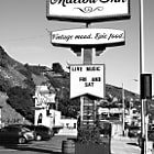 Established in 1920, the Malibu Inn was known as Malibu's chosen watering hole and host to Hollywood royalty including, Harold Lloyd and Gloria Swanson. In 1951, the Malibu Inn was moved eastward to its present location across from the Malibu pier on Pacific Coast Highway. Legendary singer-songwriter Neil Young owned the restaurant at one time and his musical influence transformed the Malibu Inn, combining its notoriety as a place for great food, with a live entertainment venue that featured some of music's most recognized performers including Eric Clapton, Tom Petty and Kid Rock.