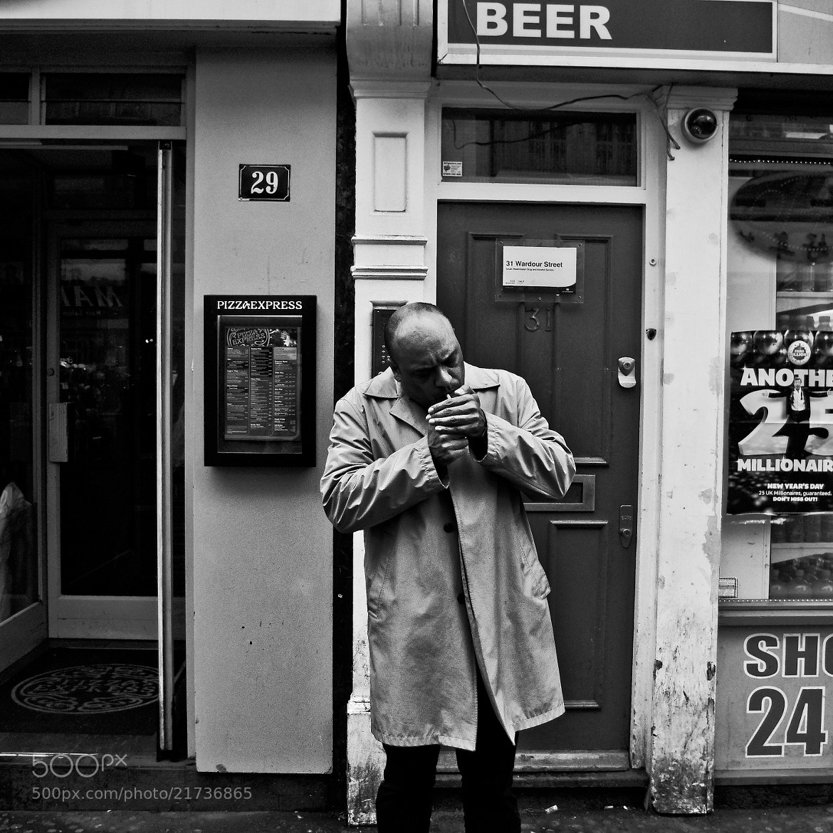 Photograph Man lighting a cigarette  by Jasper Rose on 500px