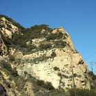 If you look closely you can see where The Pink Lady once lived. The Pink Lady was a short-lived painting on a rock face near Malibu, California in 1966. The painting was created by Lynne Seemayer, a paralegal from Northridge, California, and depicted a 60-foot (18m) tall, nude woman in a running position.