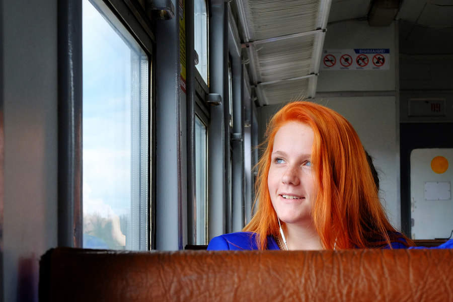 Red-hair stranger in a local train