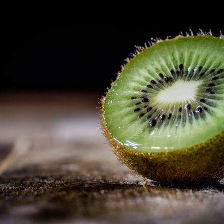 Kiwi in the old kitchen on a wooden table.