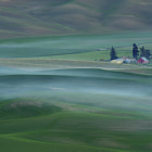 A small fire settles creating uncharacteristic ground fog in the Palouse from Steptoe Butte.