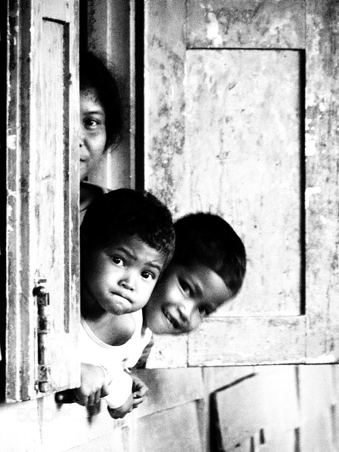 "Cute orang asli kids in Crab Island (Pulau Ketam), Selangor, Malaysia. Note: Orang Asli (lit, ""original people"", ""natural people"" or ""aboriginal people"" in Malay), is a general Malaysian term used for any indigenous groups that are found in Peninsular Malaysia."