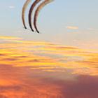 Team Aerostar flies over NAS Pensacola during the night show.