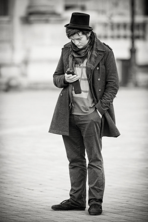 Photograph The man with the little hat was reading message on his phone by Laurent DUFOUR on 500px