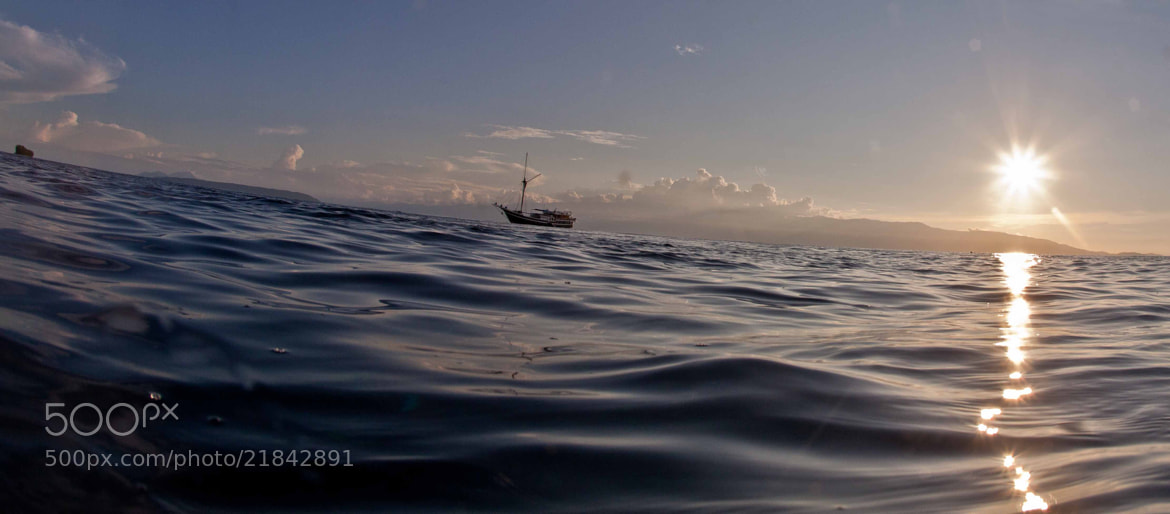 Photograph surfacing into a sunset by Paul Cowell on 500px