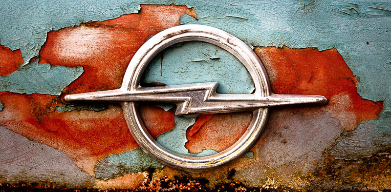 Details from a rusty Opel Rekord 1700.  This photo started my interest in car logos (both old and new) and rust.