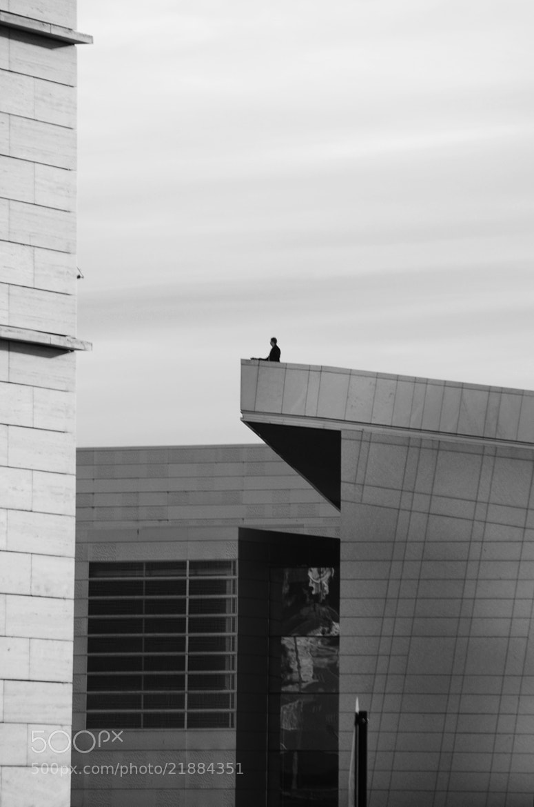 Photograph Man on rooftop by Gunnar Sommerfeldt on 500px