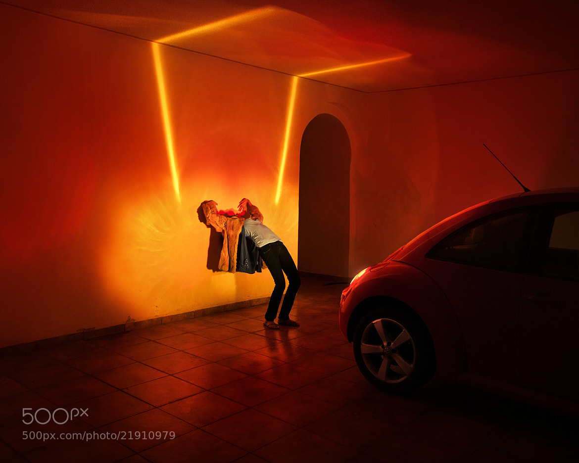 Photograph a girl, in a garage, with car on break and flashers open. by Benoit  paille on 500px