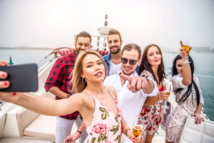 People celebrating on a yacht by fabio formaggio on 500px.com