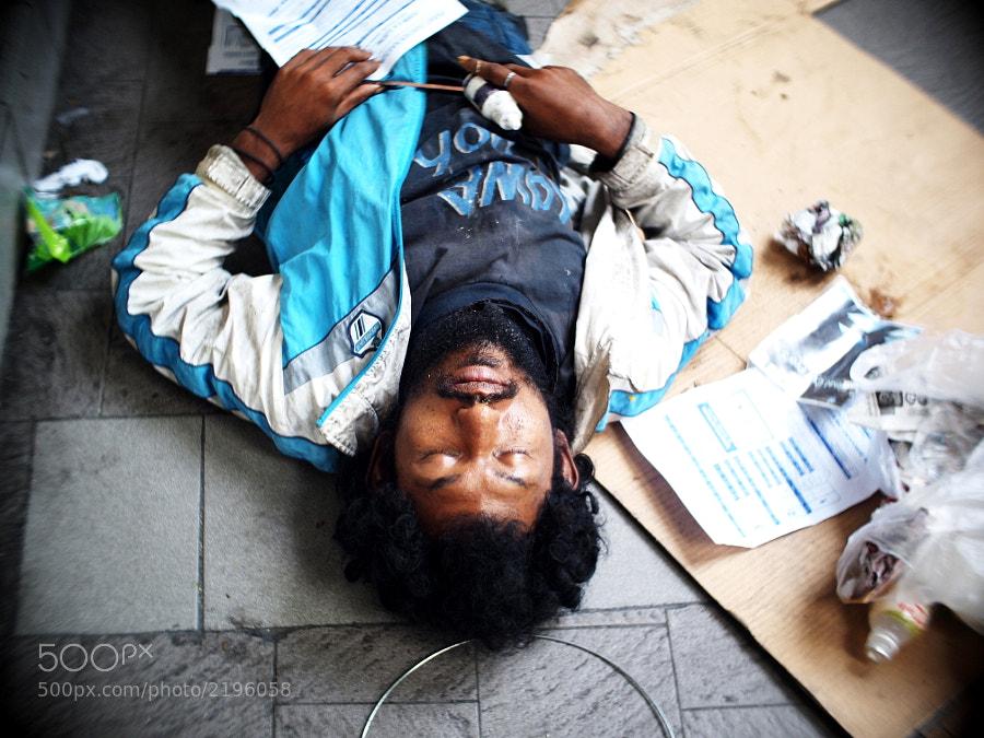 A homeless guy in busy street of Kuala Lumpur, Malaysia.