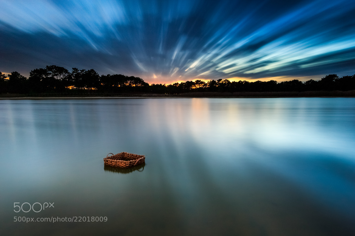 Photograph A basket on a pond by Jose Barbosa on 500px