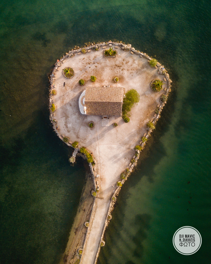 Aerial photo of the small church at the komeno by Nikolaos Diavatis on 500px.com