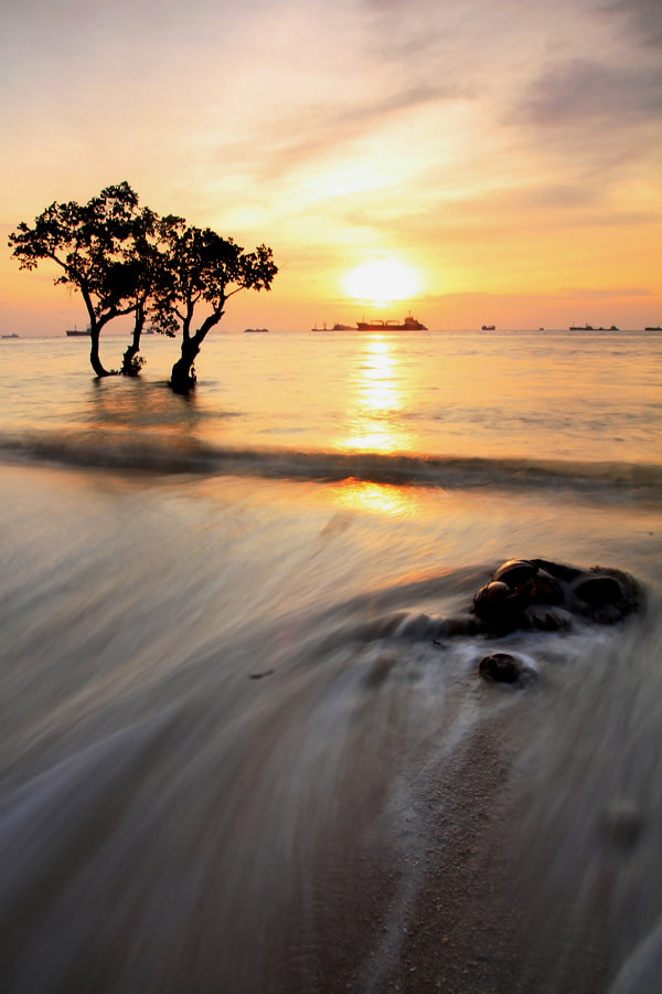 """Photograph """"The Nirwana Slow Flow's Sunset""""  by Haris Putra on 500px"""