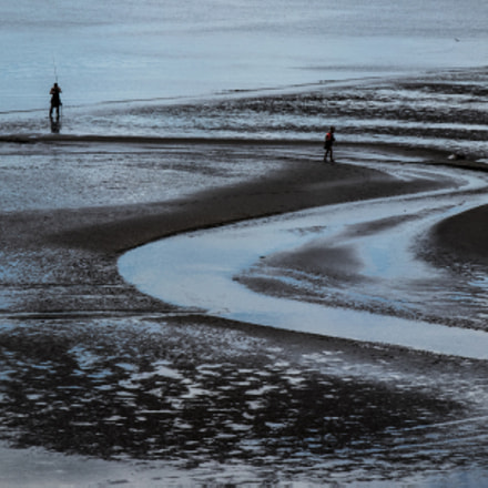 Fishing at low tide